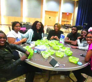 MU African Student Association members came together and invited students in creating jewelry using beads from Nigeria. (MARIANNE CAESAR/SNAPPER)