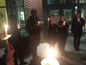 Students light candles in a moment of solidarity, honoring those who have lost their lives to terrorism. (Photo courtesy of Deanna Maurone)