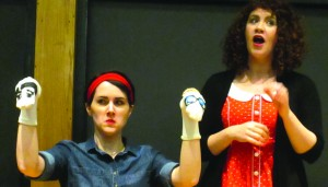 Melissa Schenter and Jade Hobbs reenacted Rosalind Franklin's life with sock puppets. Photo courtesy of Mickayla Miller.
