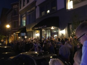 A crowd quickly formed on the sidewalk. (Allie Remis/Snapper)