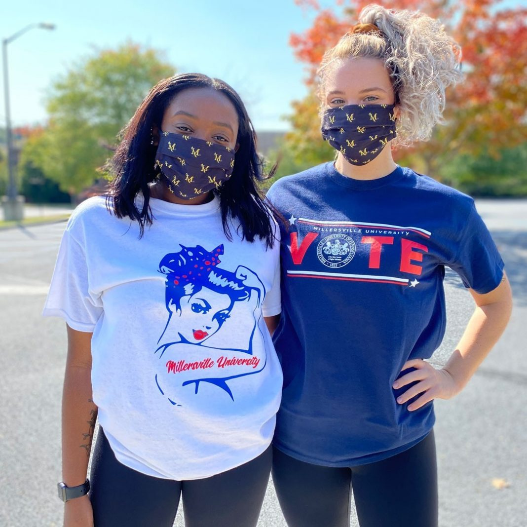 Students at Millersville showing off Voting merch
